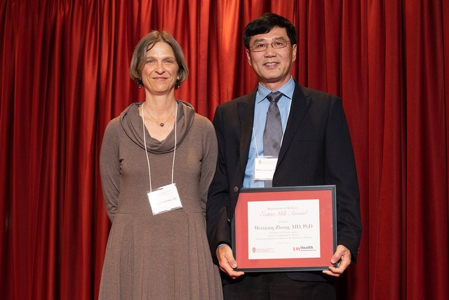 Dr. Zhong with Dr. Trowbridge, Interim Chair, Dept of Medicine (Photo courtesy of Clint Thayer, Dept. of Medicine)